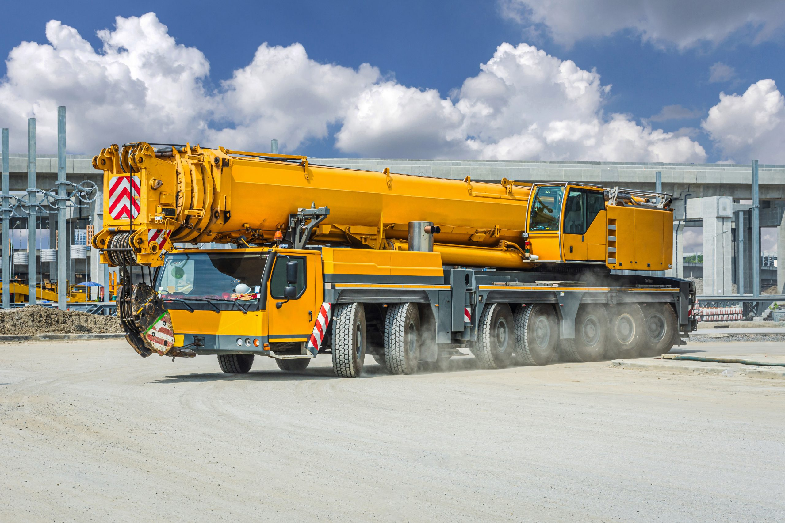 Mobile crane with cloudy sky